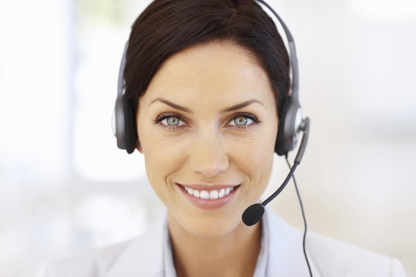 Closeup portrait of attractive customer service representative smiling